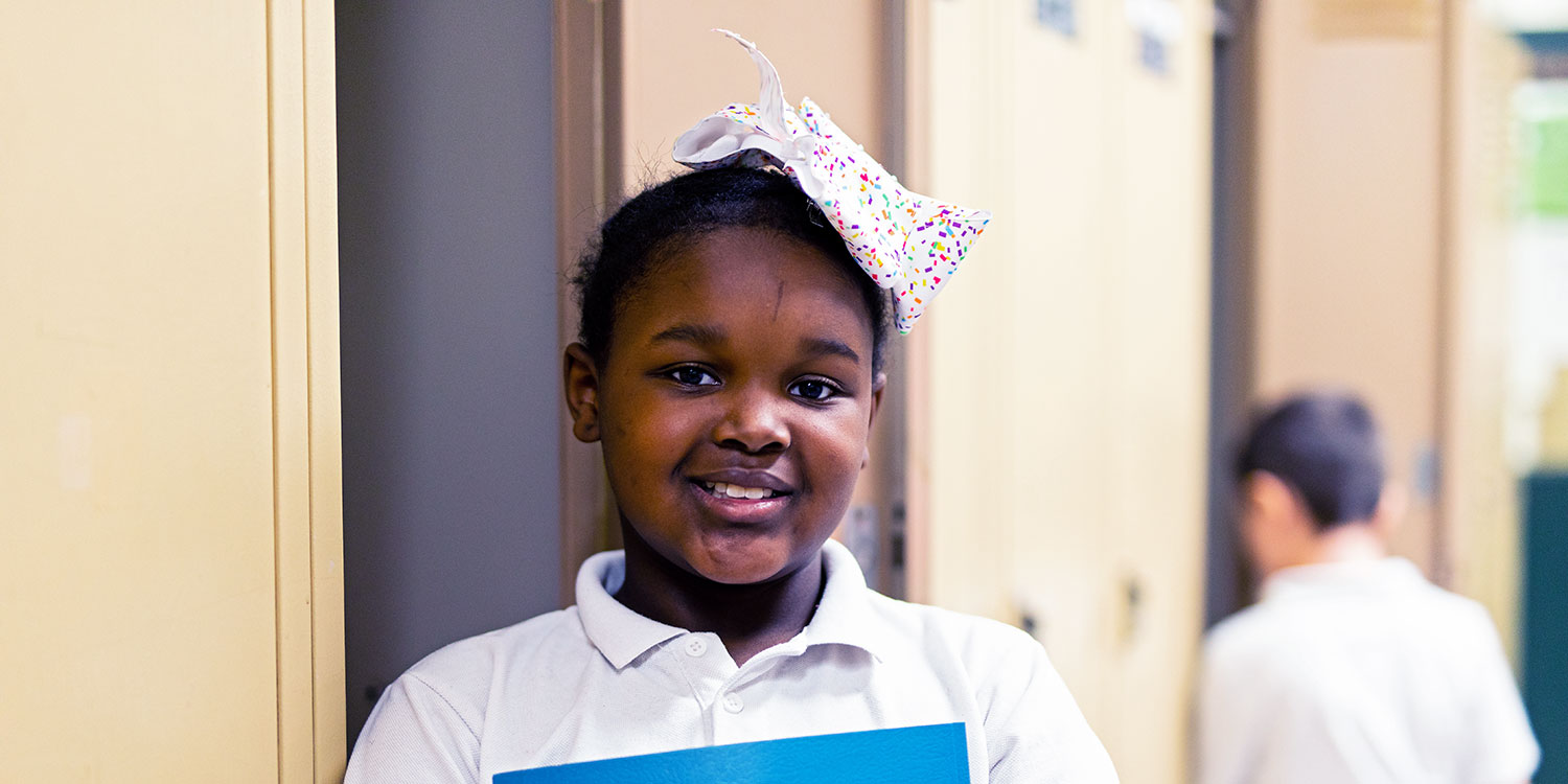 Smiling student in hallway.