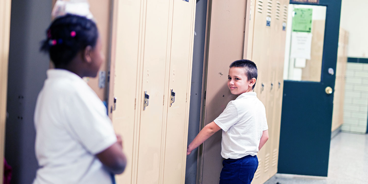 Smiling students in hallway.