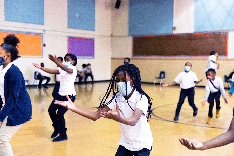 Students dancing in school gym.